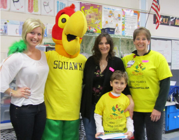 Squawk the mascot of yell and tell with teachers and Heroes